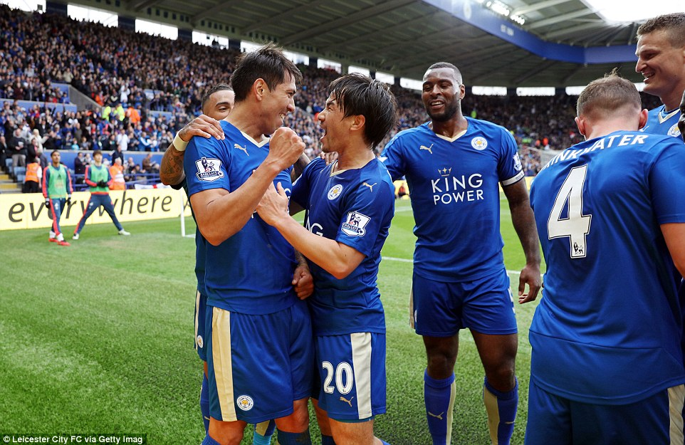 Leicester City striker Leonardo Ulloa (left) celebrates with strike partner Shinji Okazaki (centre) after scoring their third goal on Sunday