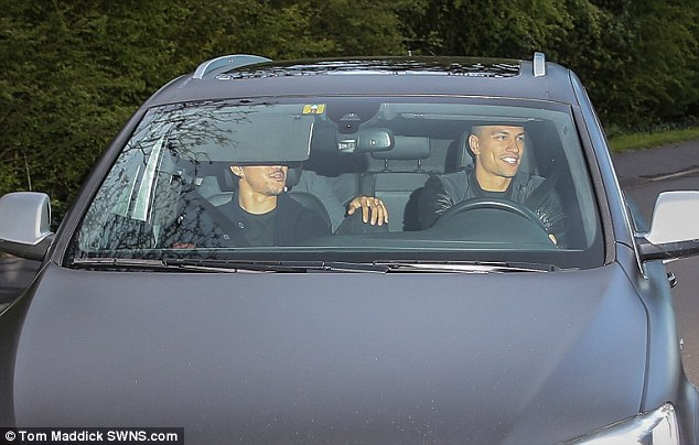 Shinji Okazaki (left) and Gorkan Inler (right) turn up at Vardys house in Melton Mowbray on Monday