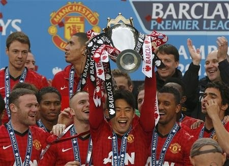 Manchester Uniteds Shinji Kagawa lifts the English Premier League trophy at Old Trafford stadium