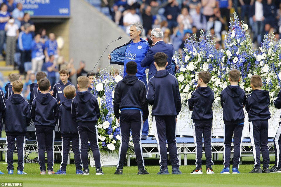 Andrea Bocelli displays his Leicester City shirt as he performs before the game as Foxes manager Claudio Ranieri looks on next to him