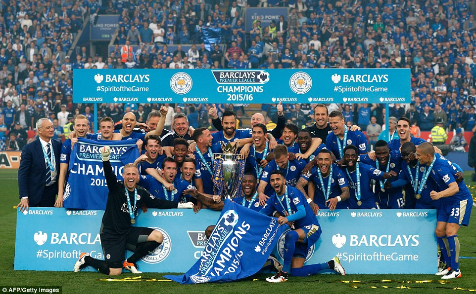 The Premier League title-winning Leicester players pose for a team photo with their crown as the celebrations continue at the King Power
