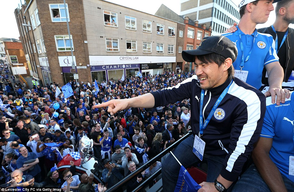 Shinji Okazaki, who was brilliant in Leicesters incredible campaign, points at the fans during the Foxes title parade on Monday