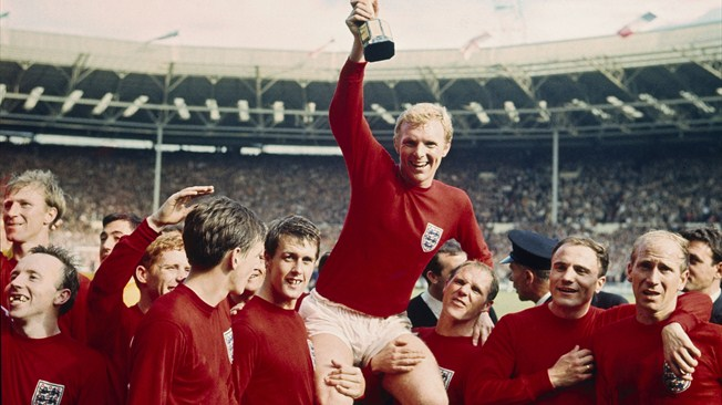 Bobby Moore raises the World Cup trophy after England defeated Germany 4-2