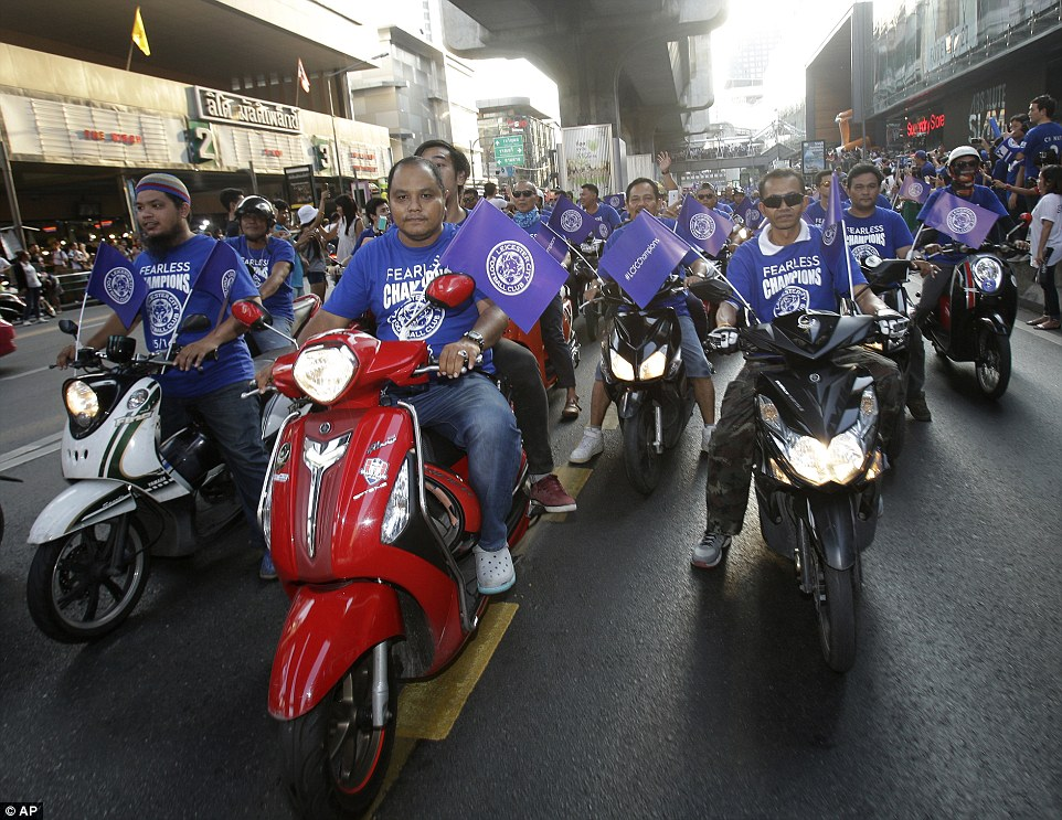 These Leicester City fans showed their support for the club by riding through the streets of Bangkok with Fearless Champions T-shirts