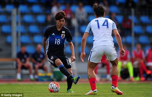 Japans Takumi Minamino does a stepover as Japan go on the attack in their final group game