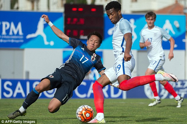 Japan defender Yosuke Ideguchi throws himself in the way of a low shot from Chelsea forward Palmer