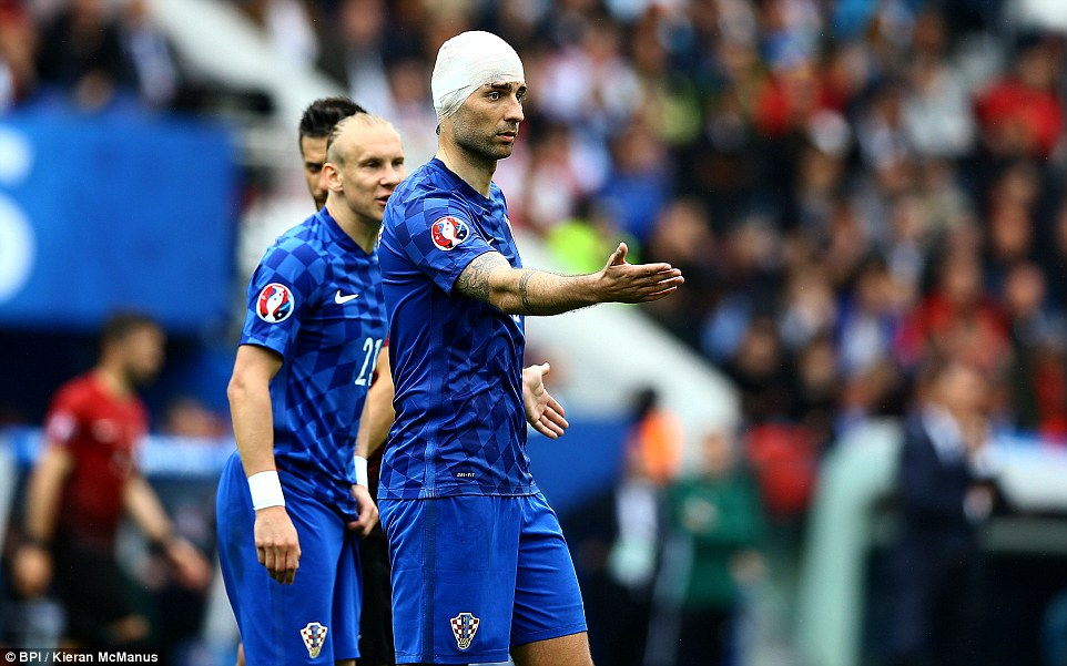 Former Tottenham defender Corluka was able to continue for Croatia but had to have his head bandaged