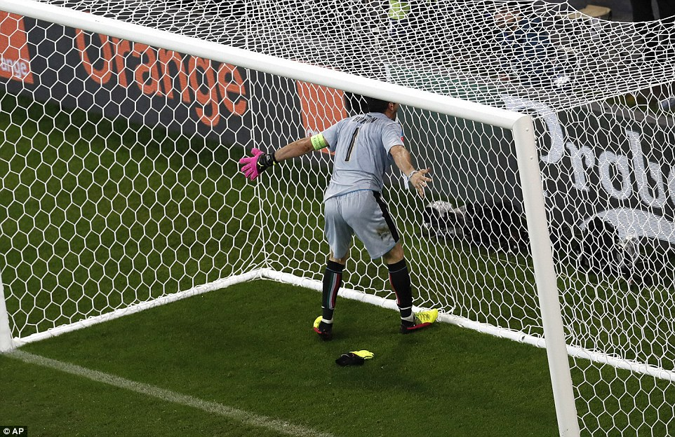 Italy goalkeeper Gianluigi Buffon celebrates after Pelles goal sent the Italians into delirium