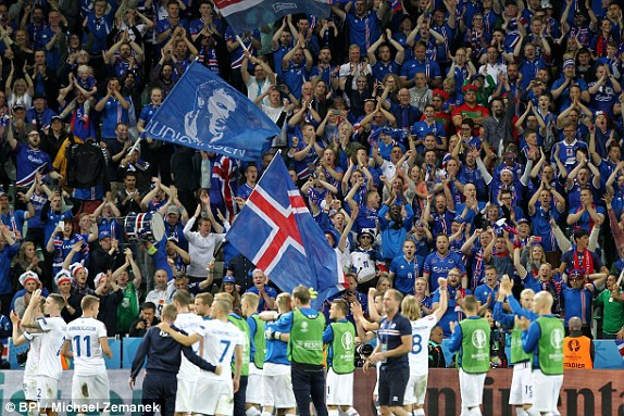 celand fans celebrates after final whistle following their 1-1 draw with giants Portugal