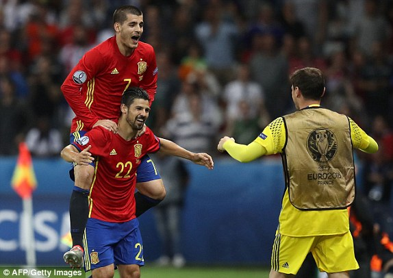 Spains forward Nolito (left) celebrates his goal with Spains other goal scorer Alvaro Morata and sub goalkeeper Iker Casillas