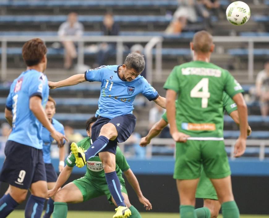 Yokohama FC striker Kazuyoshi Miura (11) heads a goal against FC Gifu on Sunday