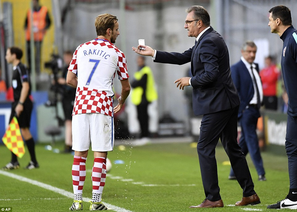 Cacic (right) issues instructions to Rakitic as his side chase the breakthrough goal against Portugal