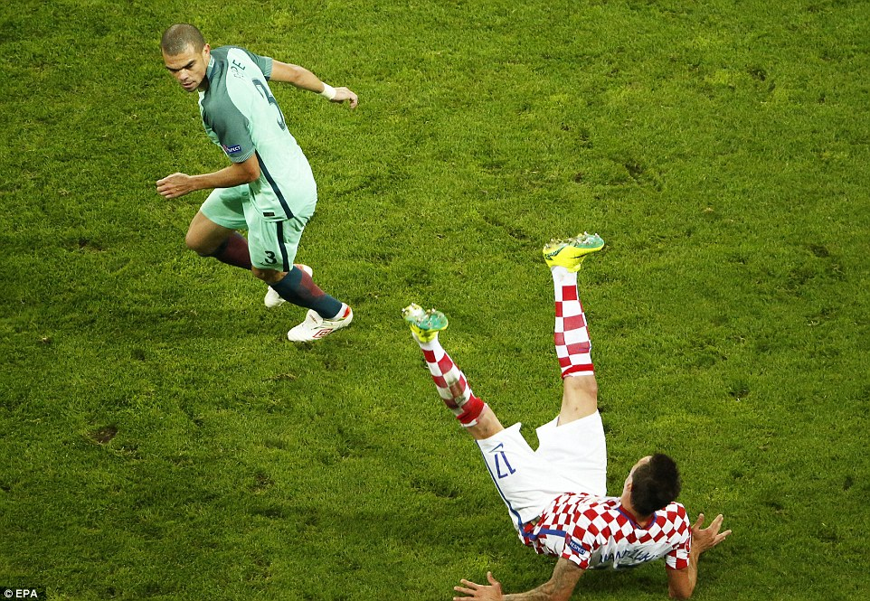 Portugal and Real Madrid defender Pepe (left) leaves Croatias Mario Mandzukic floored after a forceful challenge during Saturdays win