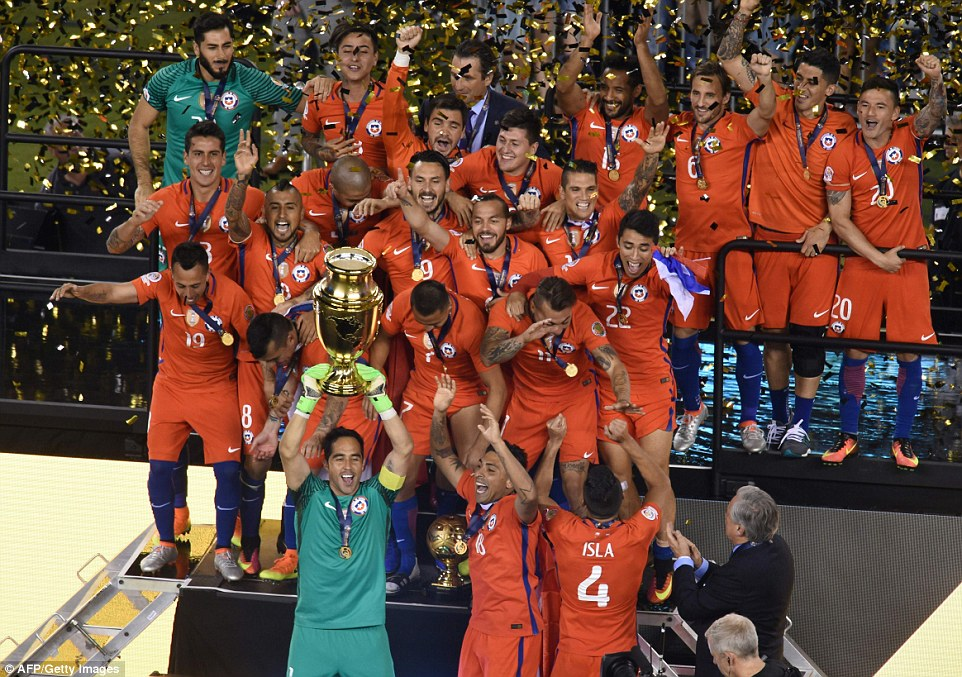 Chile goalkeeper Claudio Bravo lifts the trophy after winning the Copa America Centenario final in New Jersey