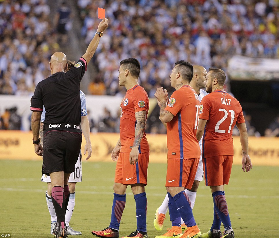 Heber Lopes shows red card to Diaz after he received a second booking for a foul on Messi