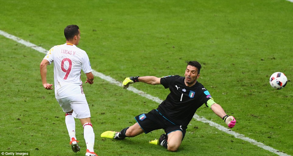 Buffon rushes his goal and spreads his body to deny Spains Lucas Vazquez from netting an equaliser against Italy