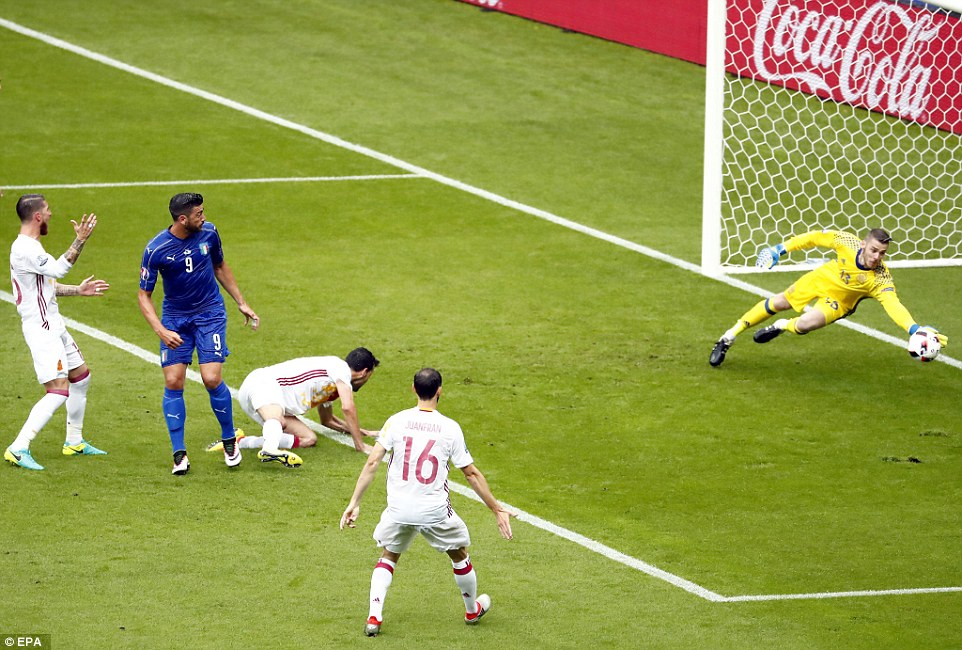 David de Gea dives to make a stunning save early on in Mondays game against Italy