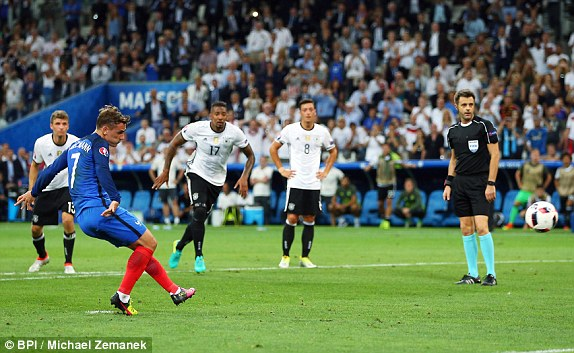 Antoine Griezmann of France scores the opening goal from the penalty spot