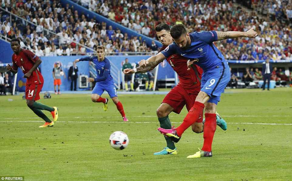 Giroud manages to steal a yard on Portugal centre back Jose Fonte to fire an effort on goal