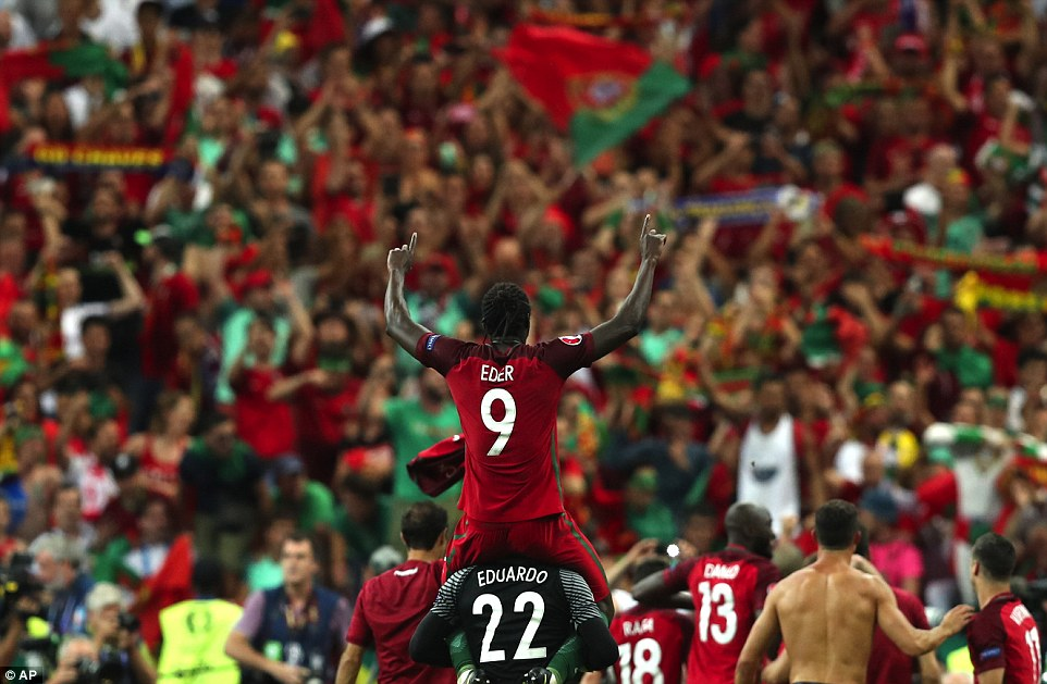 Eder is hoisted on top of reserve goalkeeper Eduardo Carvalhos shoulders among the backdrop of delirious Portugal supporters