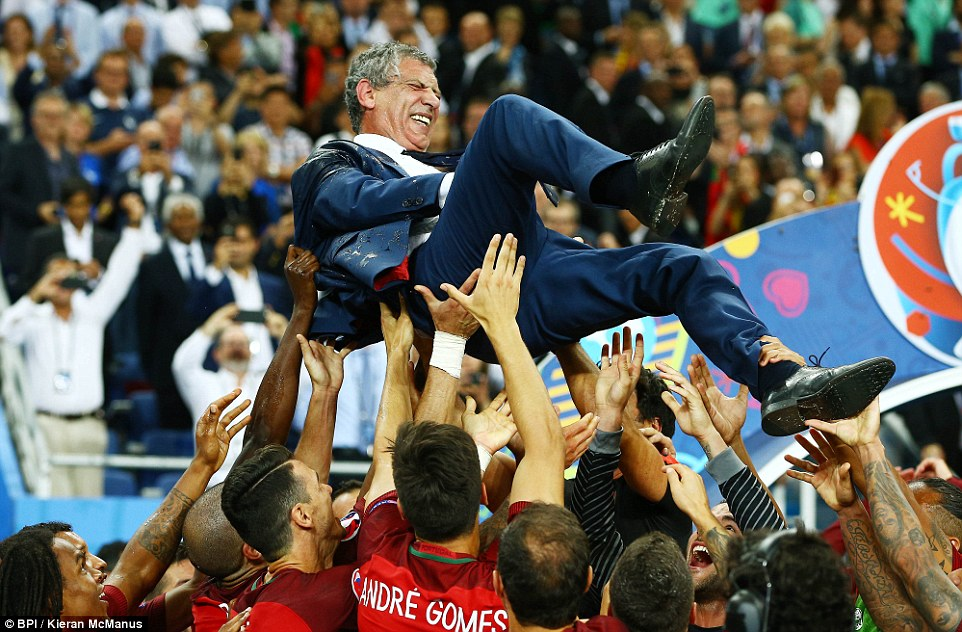 Fernando Santos in the air after he masterminded their victory at the Stade de France