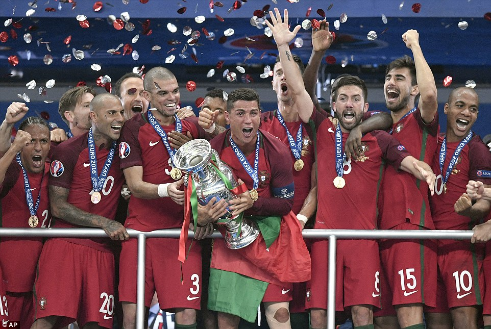 The Portugal captain and his team-mates cheer with delight after beating France 1-0 in extra-time at the Stade de France