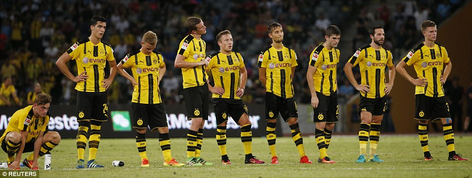 Dortmund squad line up during the penalty shootout which they eventually lost 5-6