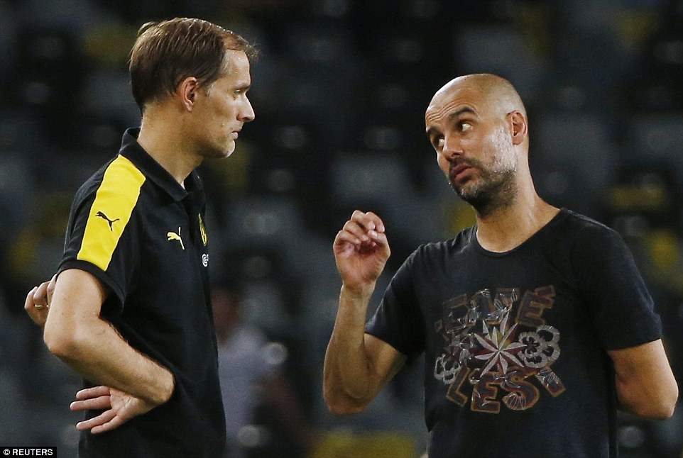 Guardiola and Tuchel (left) are involved in a stern conversation at full-time in China