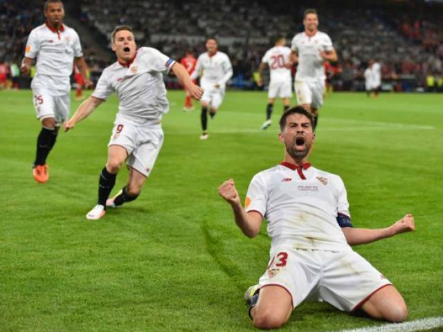 Sevilla captain Coke celebrates after scoring his second goal against Liverpool