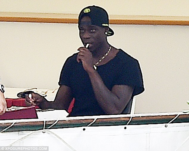 Balotelli spotted smoking while enjoying a meal at the Strainer Restaurant