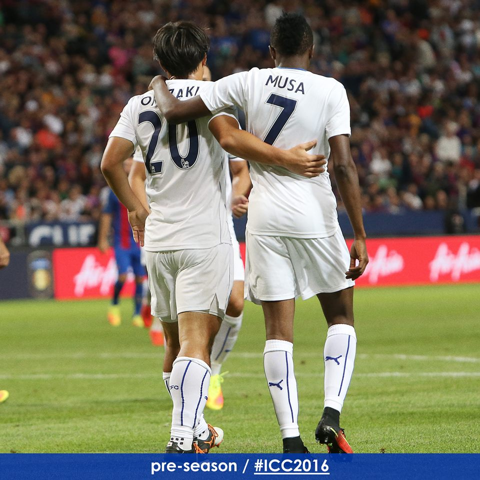 Shinji Okazaki helps Ahmed Musa celebrate his second goal of the game