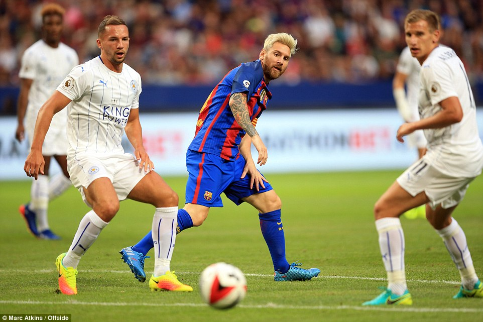 Messi watches the ball bobble loose as Marc Albrighton and Danny Drinkwater close the Argentine down