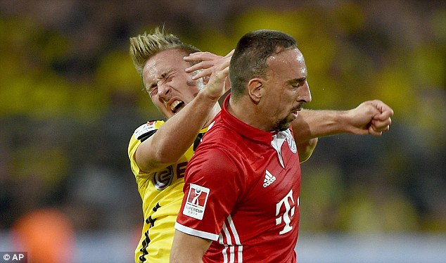 Ribery (right) was lucky to stay on the pitch after lashing out at Felix Passlack