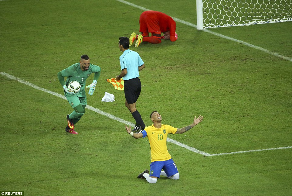 Weverton races towards Neymar who sinks to his knees after he handed the gold medal to Brazil