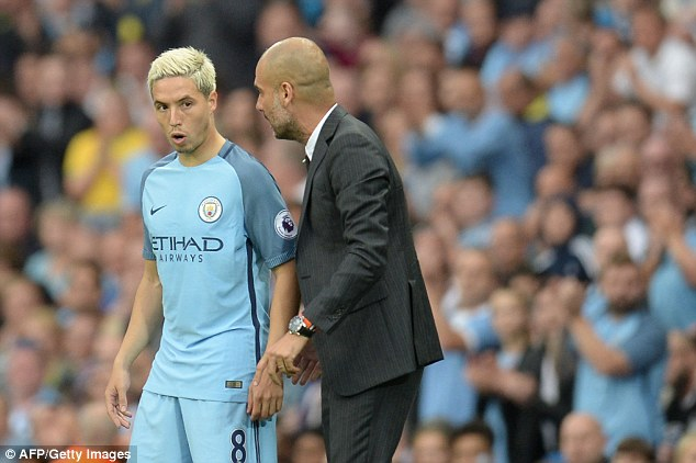 City manager Pep Guardiola, right, has told Nasri he can decide his own future