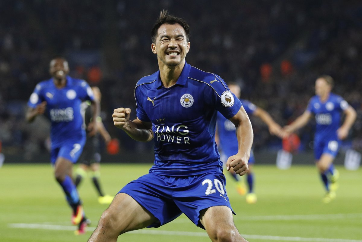 Shinji Okazaki celebrates with his Leicester team-mates after putting them 2-0 up against Chelsea