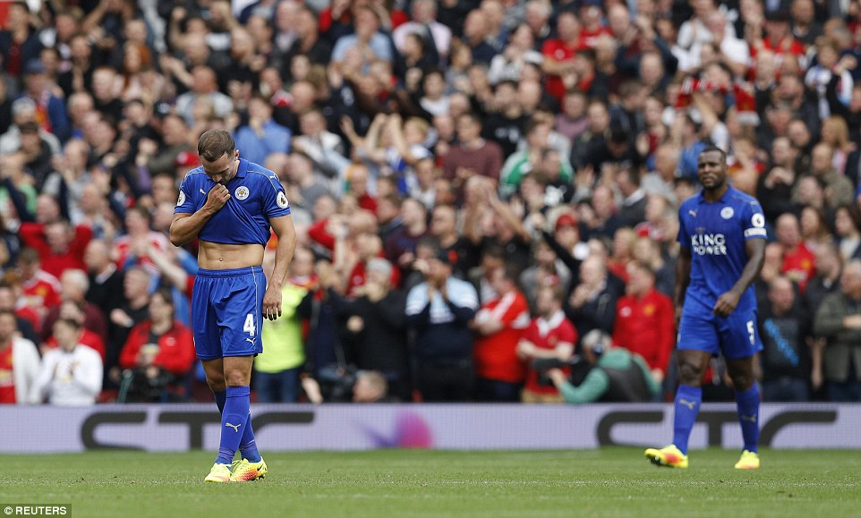 Leicester players Danny Drinkwater and Wes Morgan look stunned as the champions concede four first-half goals