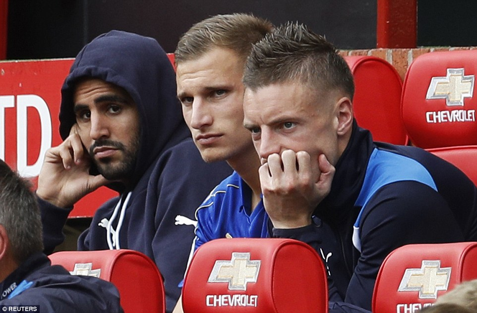 Riyad Mahrez (left), Marc Albrighton (middle) and Jamie Vardy look downbeat on the bench after being taken off