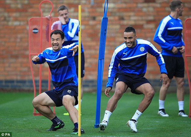Shinji Okazaki and Danny Simpson take part in a training drill ahead of a historic night