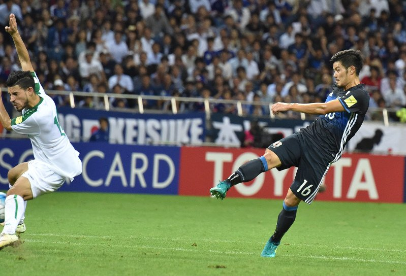 Yamaguchi nets deep in stoppage time as Japan edges Iraq