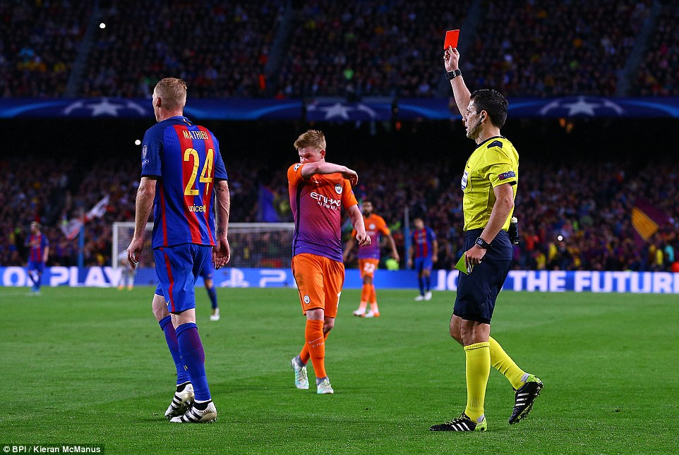 Despite Barcelonas dominance now, they too were reduced to 10 men when Jeremy Mathieu (left) was sent off