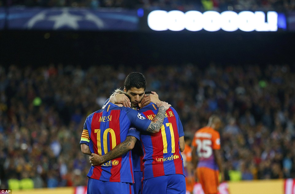 Neymar celebrates his strike with Messi and Suarez as Barca move three points clear at the top of Group C
