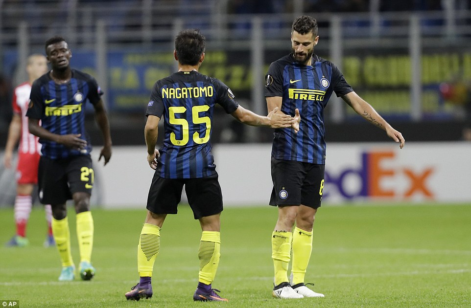 Candreva celebrates with his Inter Milan team-mate Yuto Nagatomo after scoring what turned out to be the winning goal