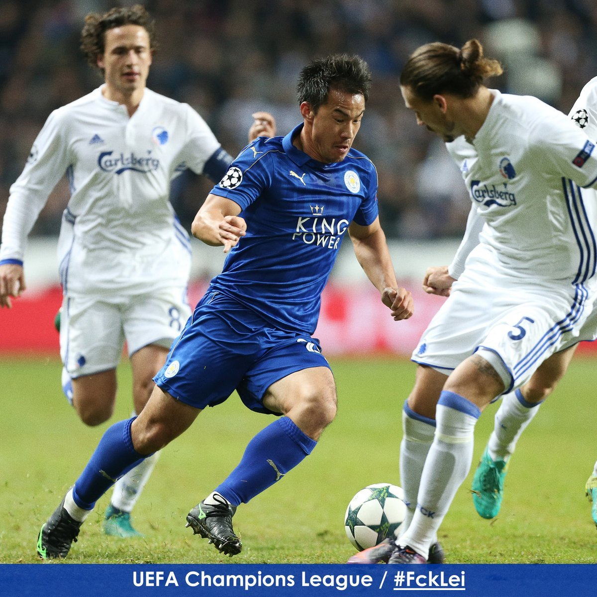 Substitute Shinji Okazaki drives at the FC Copenhagen defence as we enter the final stages here at Parken Stadium