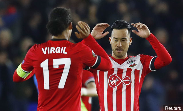 Southamptons Virgil van Dijk and Maya Yoshida celebrate after the match