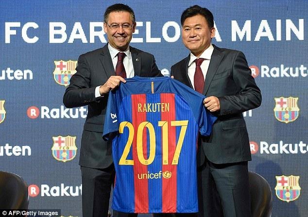 Barcelona president Josep Maria Bartomeu poses with Rakuten CEO Hiroshi Mikitani